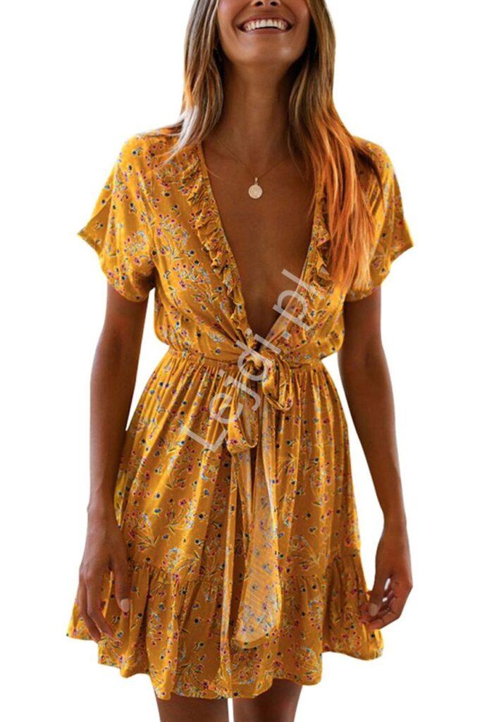 Musztardowa sukienka w kwiaty