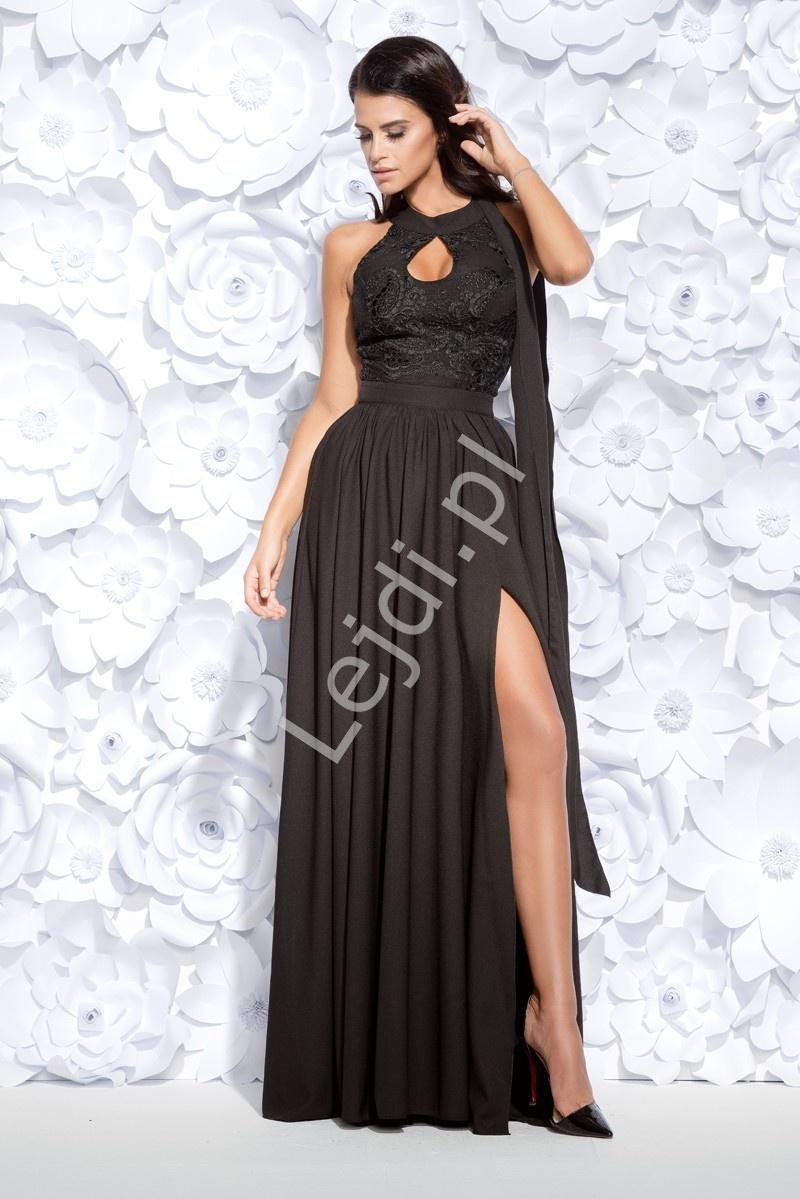 42f8a4235a Czarna długa wieczorowa suknia z rozcięciem ukazującym nogę i łezką na  dekolcie 2124-06