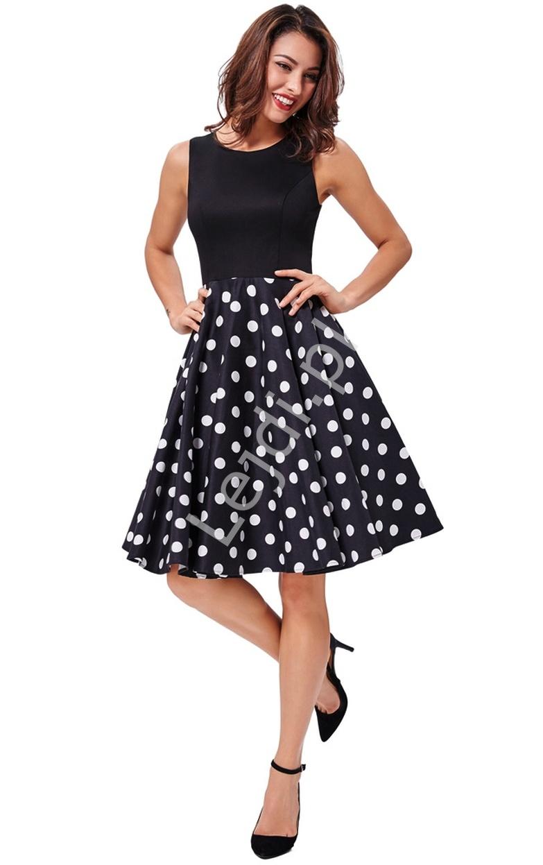 Czarna rozkloszowana sukienka z dołem w duże białe grochy