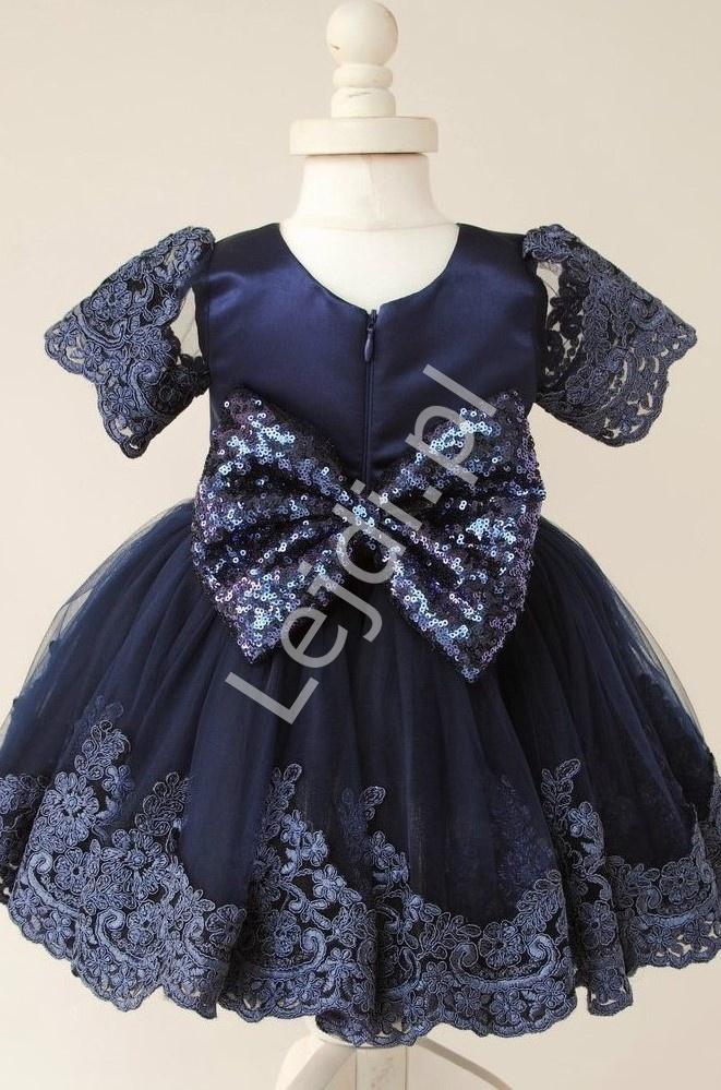 Granatowa sukienka dla dziewczynki zdobiona koronką i cekinową kokardą - Lejdi