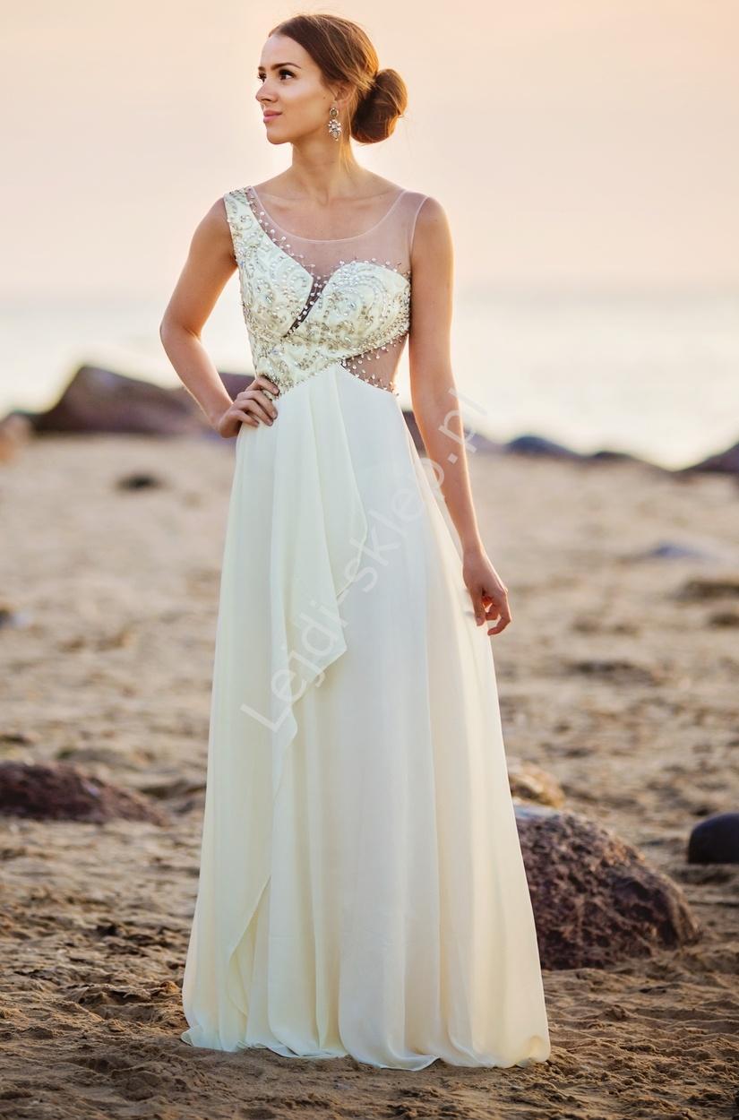 Jasnobeżowa suknia z kryształkami, haftami i asymetrycznym wycięciem - Lejdi